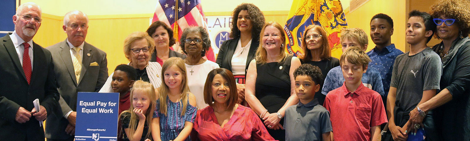 Acting Governor Sheila Y. Oliver with group of people
