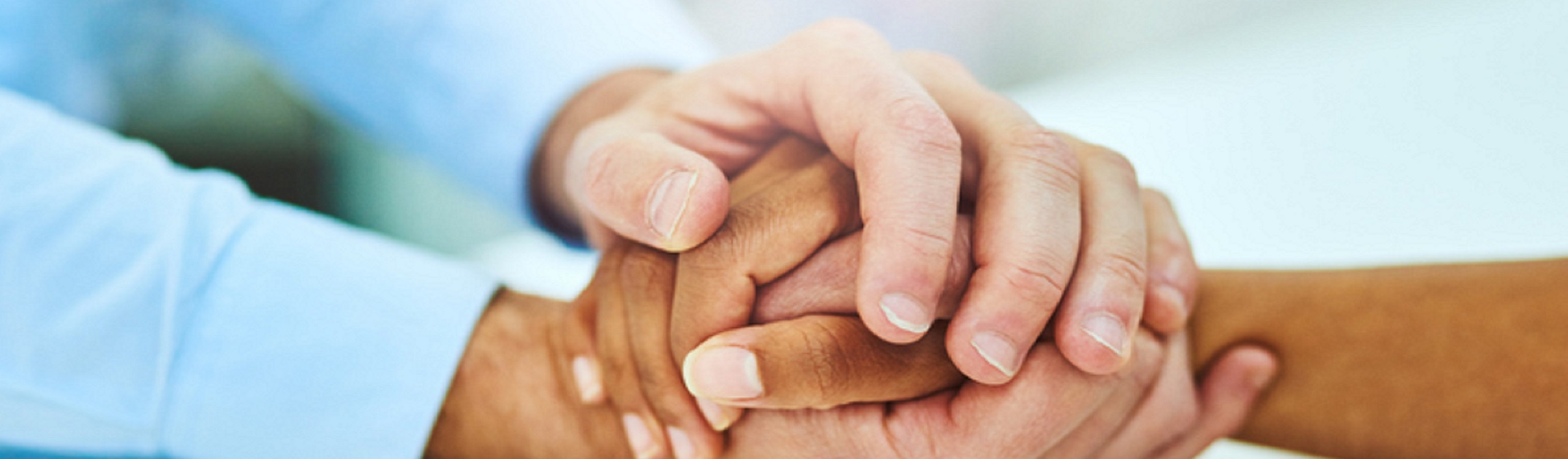 Holding hands in hospice
