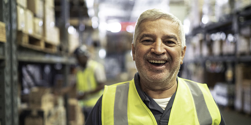 senior man working at a warehouse
