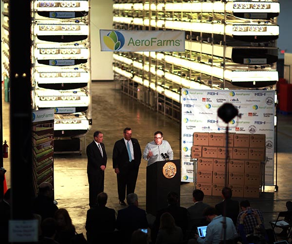 NEWARK, N.J., March 24, 2016 – Labor Commissioner Harold J. Wirths, Governor Chris Christie, and AeroFarms Chief Marketing Officer Marc Oshima at a press conference on jobs and the economy at AeroFarms in Newark. AeroFarms is the world's largest indoor vertical farm growing leafy greens and herbs without sunlight, soil or pesticides.