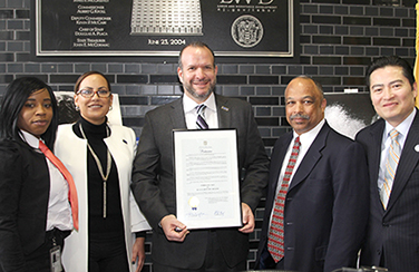 Acting Commissioner Robert Asaro-Angelo and our leadership team present a proclamation from Governor Murphy to our Black History Month chair and co-chair as we celebrate the start of Black History Month.