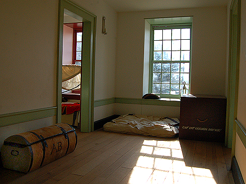 Second floor hallway of the officers' quarters - note the servant's bedding and officers' trunks