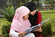 mom and girl reading a book