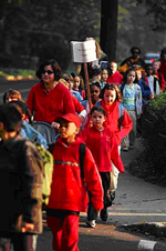 Adults walk wih children in Maplewood