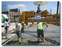 The concrete deck pour on the 14th Street Viaduct involves the process of screeding photo.