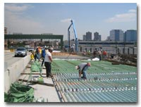 The epoxy coated reinforcing steel is installed for the concrete deck on the 14th Street Viaduct photo.