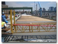 Crews work on the closure pours at deck joints and final grading of the concrete deck photo.