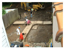 Initial clearing of road construction fill in order to expose buried historic backyard features